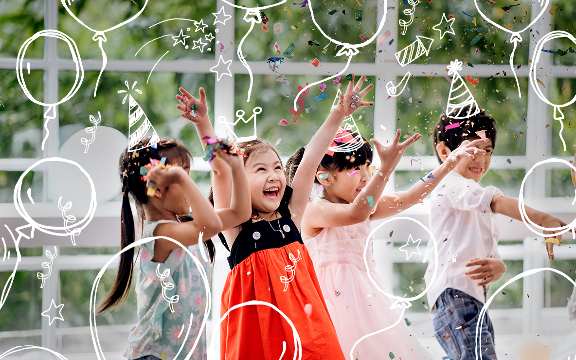 group of young children dancing in confetti