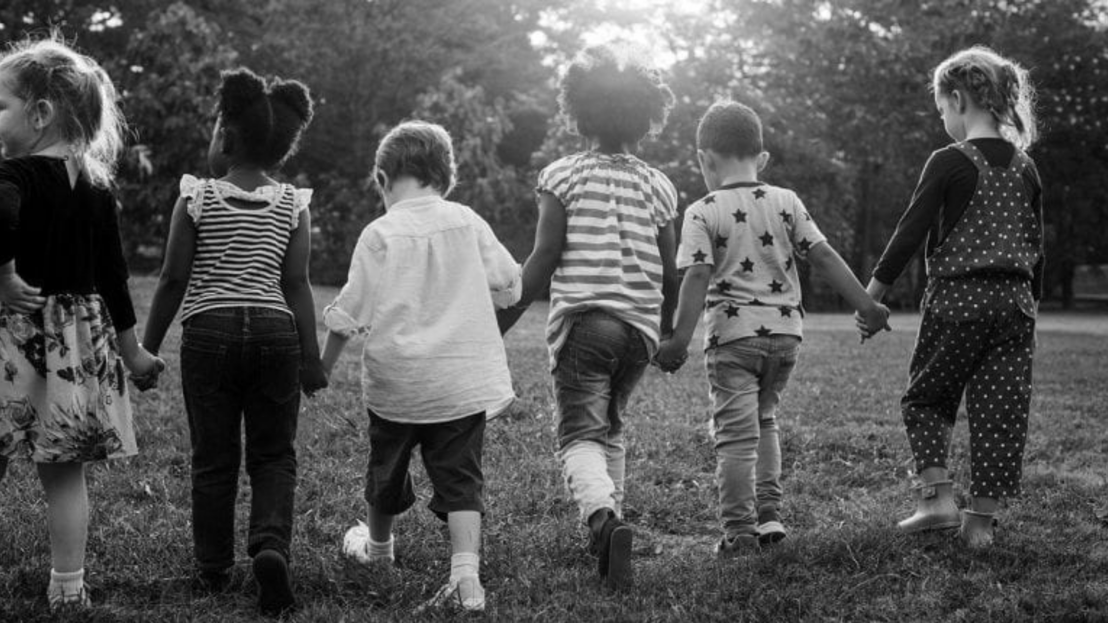 group of kids holding hands and walking