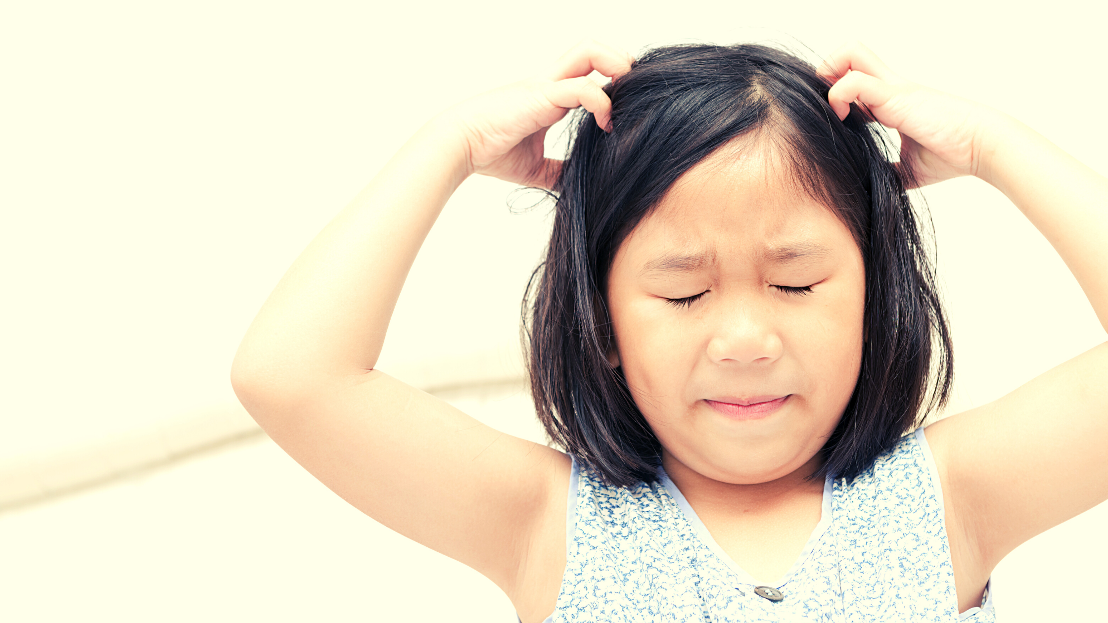 Girl scratching head because of lice